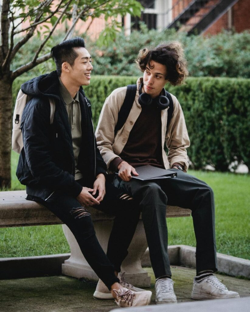 two teenagers sitting together reading body language